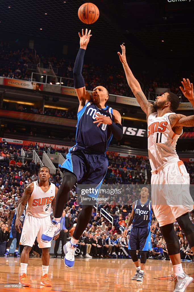 <a gi-track='captionPersonalityLinkClicked' href=/galleries/search?phrase=Shawn+Marion&family=editorial&specificpeople=201566 ng-click='$event.stopPropagation()'>Shawn Marion</a> #0 of the Dallas Mavericks shoots against the Phoenix Suns on December 21, 2013 at U.S. Airways Center in Phoenix, Arizona.
