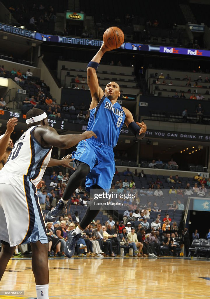 <a gi-track='captionPersonalityLinkClicked' href=/galleries/search?phrase=Shawn+Marion&family=editorial&specificpeople=201566 ng-click='$event.stopPropagation()'>Shawn Marion</a> #0 of the Dallas Mavericks shoots against <a gi-track='captionPersonalityLinkClicked' href=/galleries/search?phrase=Zach+Randolph&family=editorial&specificpeople=201595 ng-click='$event.stopPropagation()'>Zach Randolph</a> #50 of the Memphis Grizzlies during a game on October 9, 2013 at FedExForum in Memphis, Tennessee.