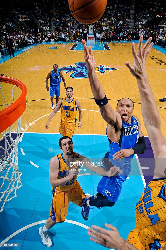 <a gi-track='captionPersonalityLinkClicked' href=/galleries/search?phrase=Shawn+Marion&family=editorial&specificpeople=201566 ng-click='$event.stopPropagation()'>Shawn Marion</a> #0 of the Dallas Mavericks shoots in the lane against <a gi-track='captionPersonalityLinkClicked' href=/galleries/search?phrase=Robin+Lopez&family=editorial&specificpeople=2351509 ng-click='$event.stopPropagation()'>Robin Lopez</a> #15 and Ryan Anderson #33 of the New Orleans Hornets on February 22, 2013 at the New Orleans Arena in New Orleans, Louisiana.