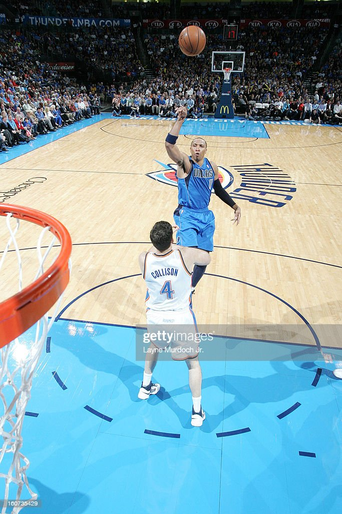 <a gi-track='captionPersonalityLinkClicked' href=/galleries/search?phrase=Shawn+Marion&family=editorial&specificpeople=201566 ng-click='$event.stopPropagation()'>Shawn Marion</a> #0 of the Dallas Mavericks shoots over <a gi-track='captionPersonalityLinkClicked' href=/galleries/search?phrase=Nick+Collison&family=editorial&specificpeople=202843 ng-click='$event.stopPropagation()'>Nick Collison</a> #4 of the Oklahoma City Thunder on February 04, 2013 at the Chesapeake Energy Arena in Oklahoma City, Oklahoma.