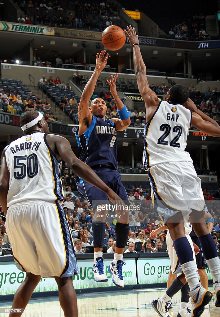 Shawn Marion #0 of the Dallas Mavericks shoots over Rudy Gay #22 and Zach Randolph #50 of the Memphis Grizzlies on March 31, 2010 at FedExForum in Memphis, Tennessee.