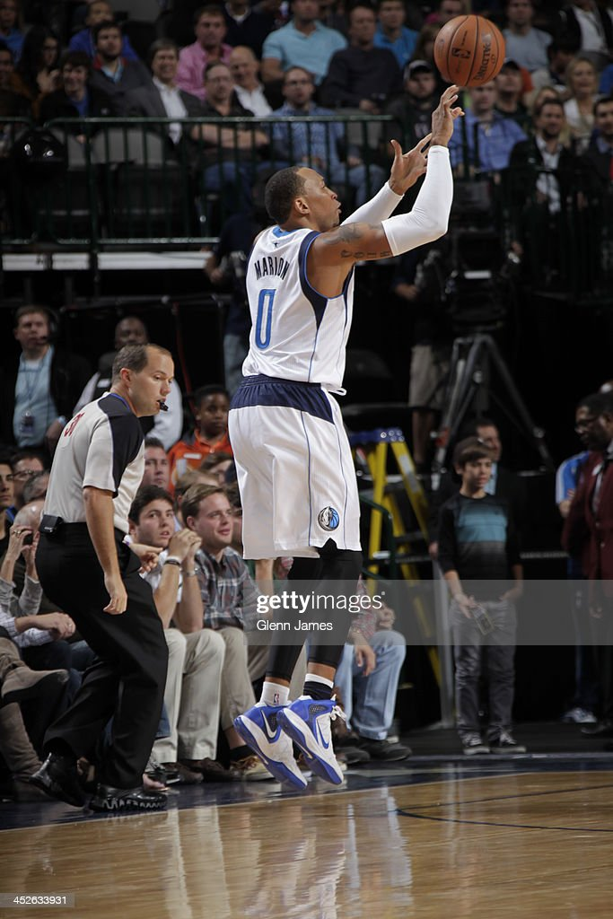 <a gi-track='captionPersonalityLinkClicked' href=/galleries/search?phrase=Shawn+Marion&family=editorial&specificpeople=201566 ng-click='$event.stopPropagation()'>Shawn Marion</a> #0 of the Dallas Mavericks shoots the ball against the Houston Rockets on November 20, 2013 at the American Airlines Center in Dallas, Texas.