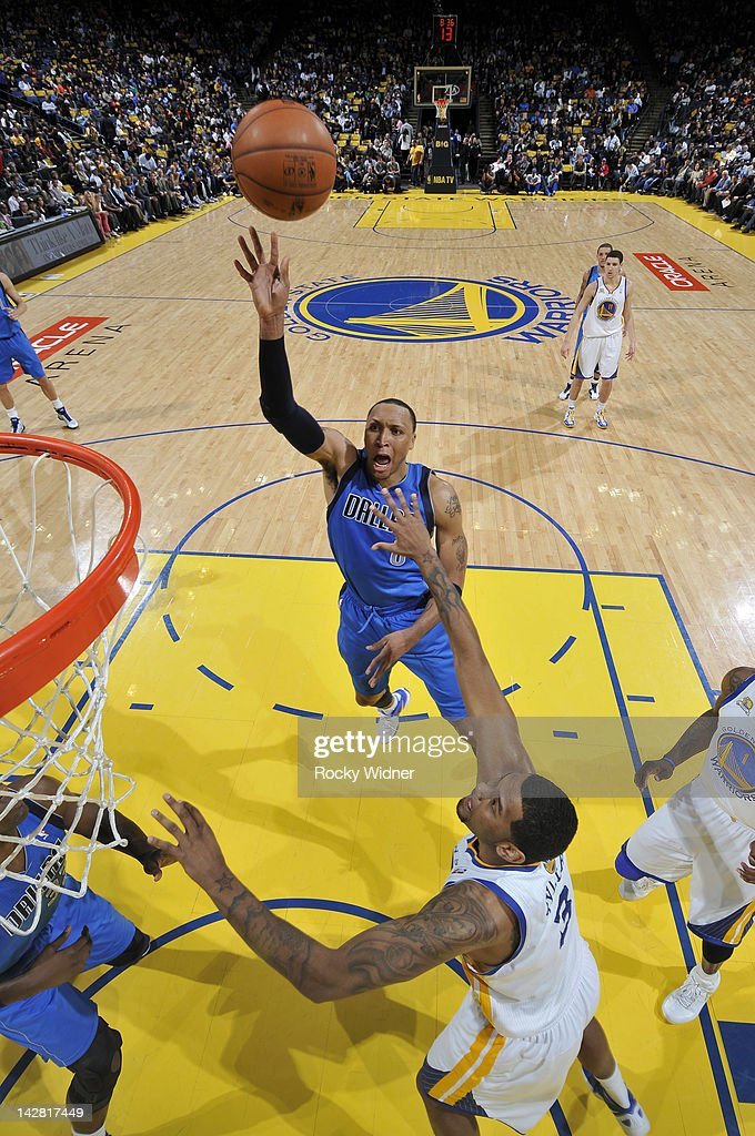 <a gi-track='captionPersonalityLinkClicked' href=/galleries/search?phrase=Shawn+Marion&family=editorial&specificpeople=201566 ng-click='$event.stopPropagation()'>Shawn Marion</a> #0 of the Dallas Mavericks shoots the ball over Jeremy Tyler #3 of the Golden State Warriors on April 12, 2012 at Oracle Arena in Oakland, California.