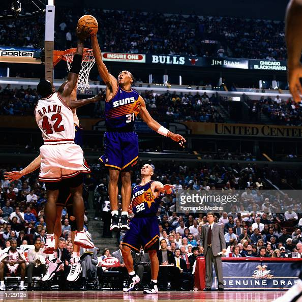 Shawn Marion of the Phoenix Suns goes up high to block a shot attempt by Elton Brand of the Chicago Bulls during a 2000 NBA game at the United Center...