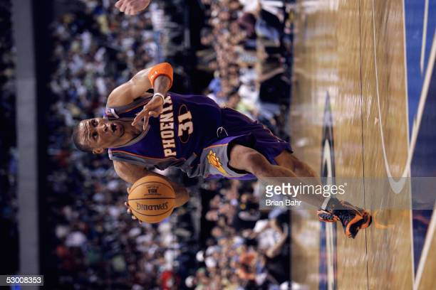 Shawn Marion of the Phoenix Suns moves the ball in Game six of the Western Conference Semifinals with the Dallas Mavericks during the 2005 NBA...