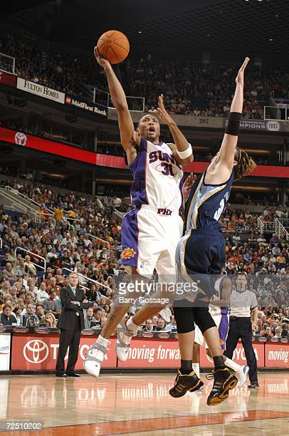 Shawn Marion of the Phoenix Suns shoots over Mike Miller of the Memphis Grizzlies on November 11 2006 at US Airways Center in Phoenix Arizona NOTE TO...