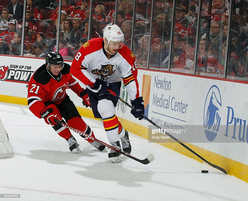 Shawn Matthias #18 of the Florida Panthers and <a gi-track='captionPersonalityLinkClicked' href=/galleries/search?phrase=Andrei+Loktionov&family=editorial&specificpeople=5370946 ng-click='$event.stopPropagation()'>Andrei Loktionov</a> #21 of the New Jersey Devils pursue a loose puck during the game at the Prudential Center on March 23, 2013 in Newark, New Jersey.