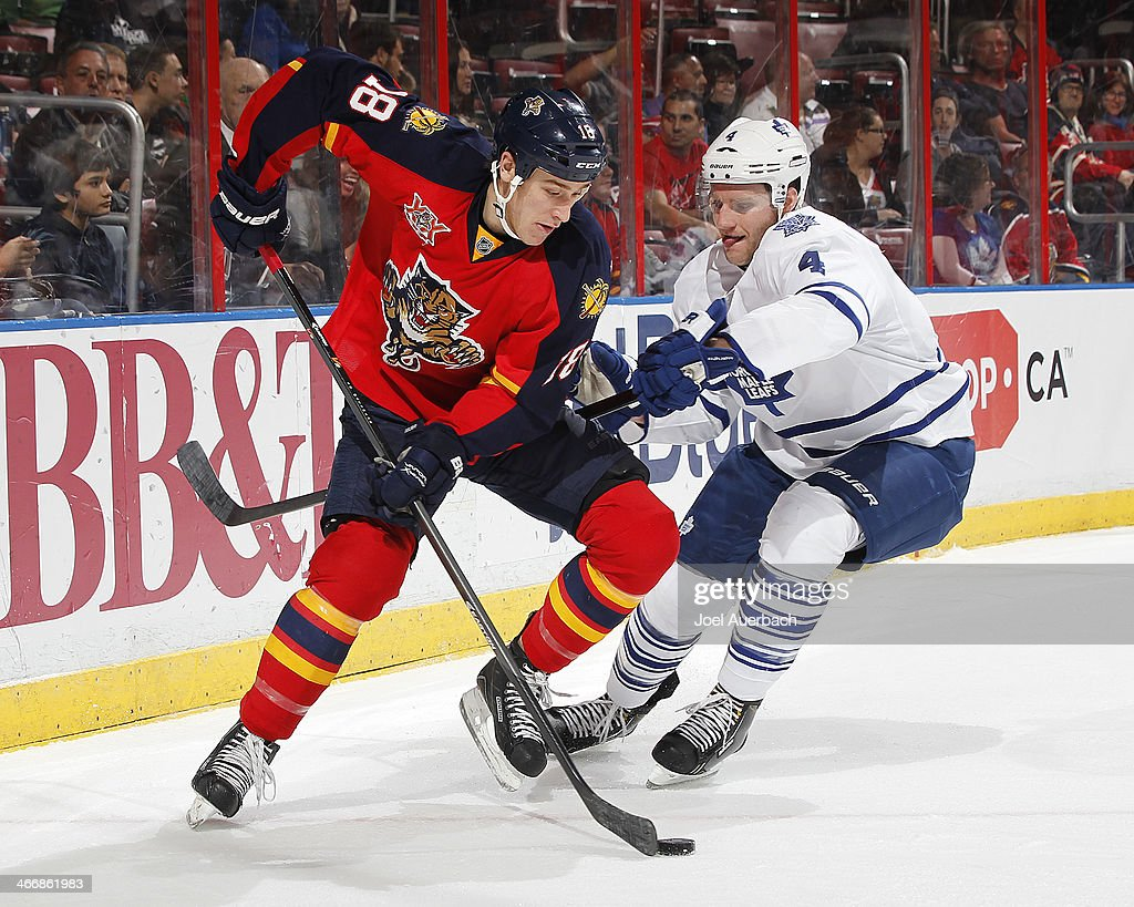 Shawn Matthias #18 of the Florida Panthers and Cody Franson #4 of the Toronto Maple Leafs fight for control of the puck during first period action at the BB&T Center on February 4, 2014 in Sunrise, Florida.