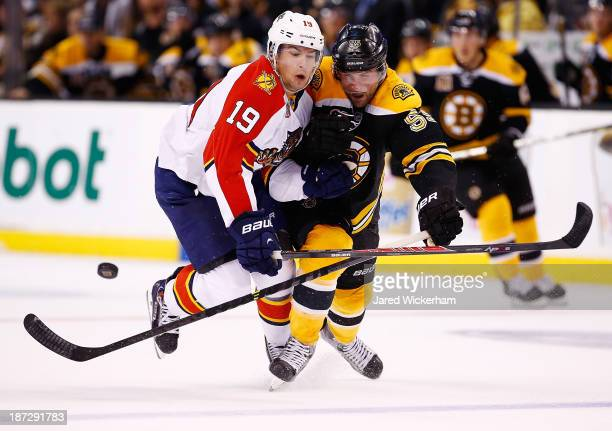 Shawn Matthias of the Florida Panthers battles for the puck against Johnny Boychuk of the Boston Bruins in the second period at TD Garden on November...