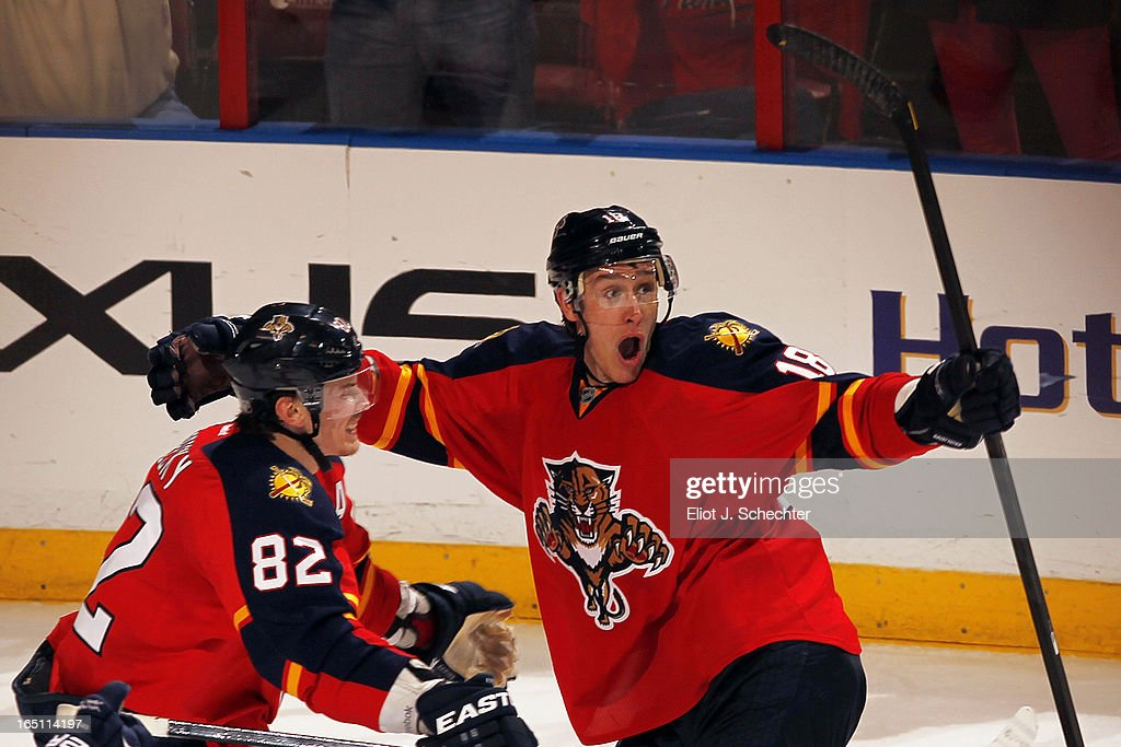 Shawn Matthias #18 of the Florida Panthers celebrates his goal with teammate <a gi-track='captionPersonalityLinkClicked' href=/galleries/search?phrase=Tomas+Kopecky&family=editorial&specificpeople=2234349 ng-click='$event.stopPropagation()'>Tomas Kopecky</a> #82 against the New Jersey Devils in the final seconds of the third period to tie the game at the BB&T Center on March 30, 2013 in Sunrise, Florida.