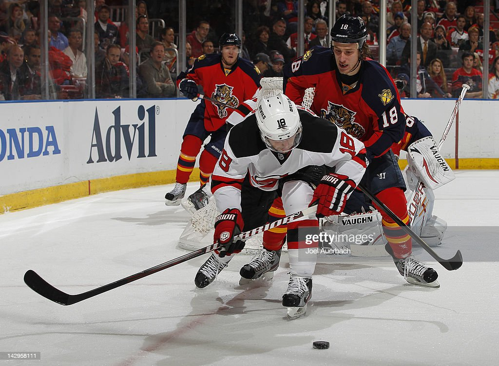 Shawn Matthias #18 of the Florida Panthers checks <a gi-track='captionPersonalityLinkClicked' href=/galleries/search?phrase=Steve+Bernier&family=editorial&specificpeople=557040 ng-click='$event.stopPropagation()'>Steve Bernier</a> #18 of the New Jersey Devils off the puck in Game Two of the Eastern Conference Quarterfinals during the 2012 NHL Stanley Cup Playoffs at the BankAtlantic Center on April 15, 2012 in Sunrise, Florida. The Panthers defeated the Devils 4-2.