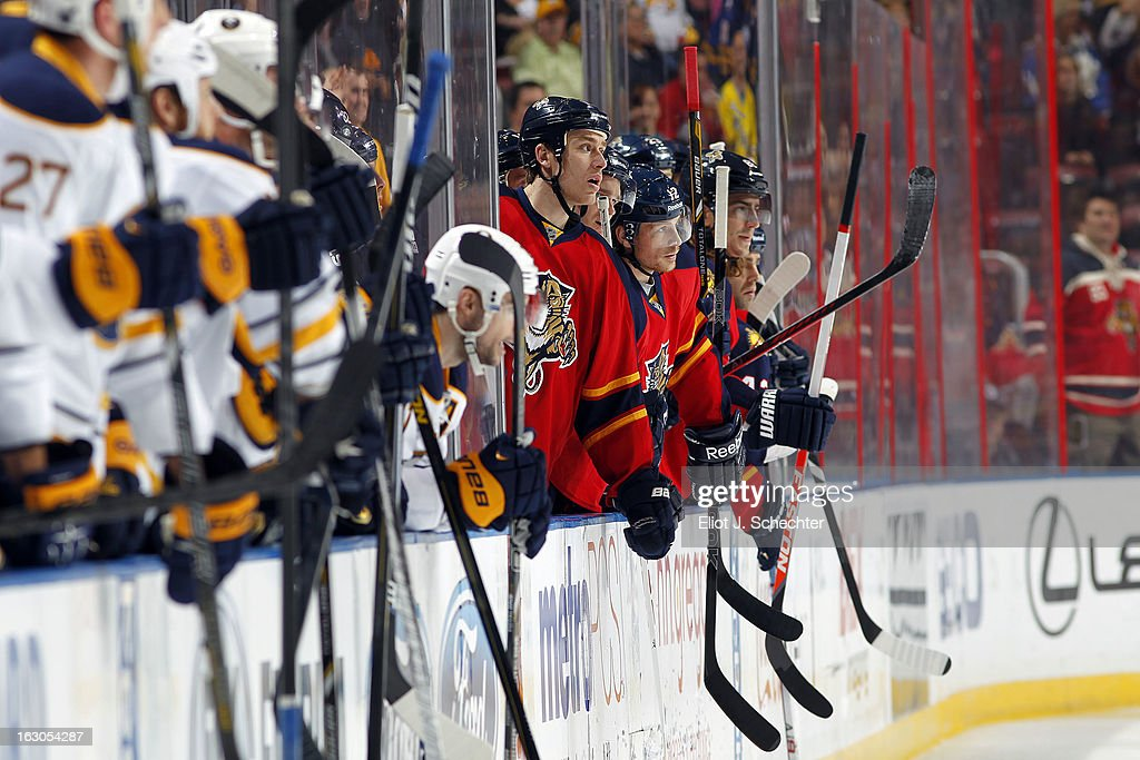 Shawn Matthias #18 of the Florida Panthers cheers on while teammate George Parros #22 fights John Scott #32 of the Buffalo Sabres at the BB&T Center on February 28, 2013 in Sunrise, Florida.