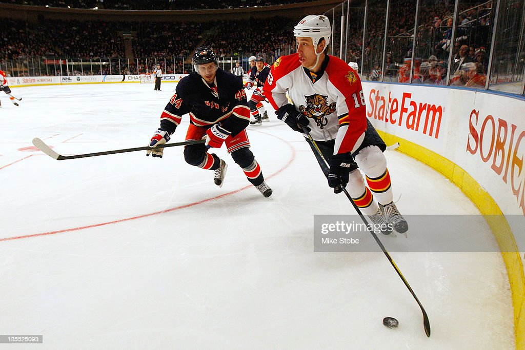 Shawn Matthias of the Florida Panthers controls the puck in front of Steve Eminger of the New York Rangers at Madison Square Garden on December11...