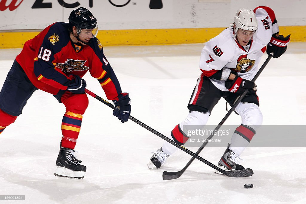 Shawn Matthias #18 of the Florida Panthers crosses sticks with <a gi-track='captionPersonalityLinkClicked' href=/galleries/search?phrase=Kyle+Turris&family=editorial&specificpeople=4251834 ng-click='$event.stopPropagation()'>Kyle Turris</a> #7 of the Ottawa Senators at the BB&T Center on April 7, 2013 in Sunrise, Florida.