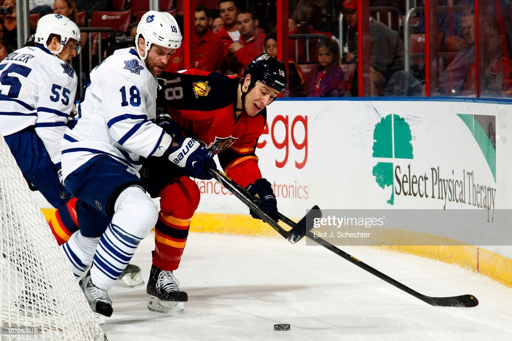 Shawn Matthias #18 of the Florida Panthers digs the puck out from the boards against Mike Brown #18 of the Toronto Maple Leafs at the BB&T Center on February 18, 2013 in Sunrise, Florida.