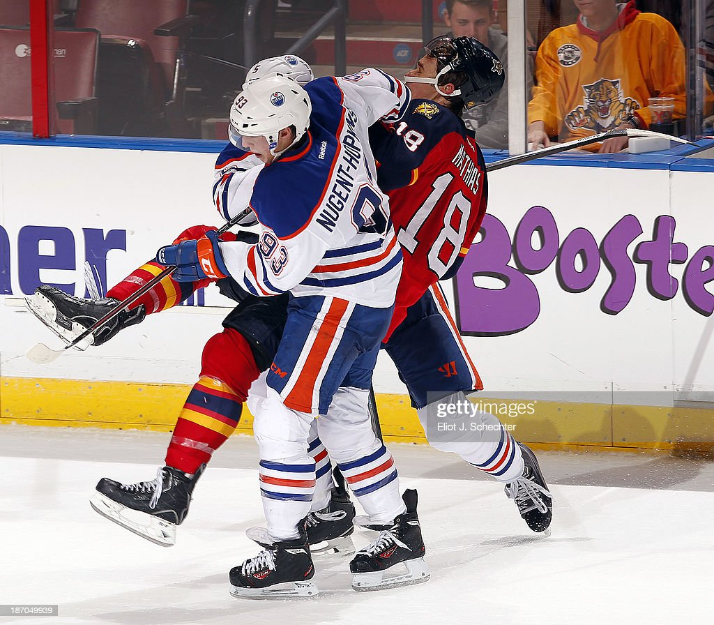 Shawn Matthias #18 of the Florida Panthers gets sandwiched between <a gi-track='captionPersonalityLinkClicked' href=/galleries/search?phrase=Ryan+Nugent-Hopkins&family=editorial&specificpeople=7144190 ng-click='$event.stopPropagation()'>Ryan Nugent-Hopkins</a> #93 and Ladislav Smid #5 of the Edmonton Oilers at the BB&T Center on November 5, 2013 in Sunrise, Florida.