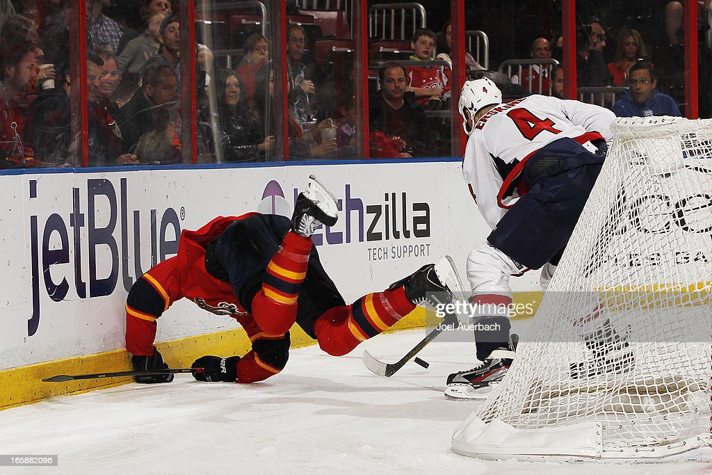 Shawn Matthias #18 of the Florida Panthers is upended by <a gi-track='captionPersonalityLinkClicked' href=/galleries/search?phrase=John+Erskine&family=editorial&specificpeople=215268 ng-click='$event.stopPropagation()'>John Erskine</a> #4 of the Washington Capitals at the BB&T Center on April 6, 2013 in Sunrise, Florida. The Capitals defeated the Panthers 4-3.