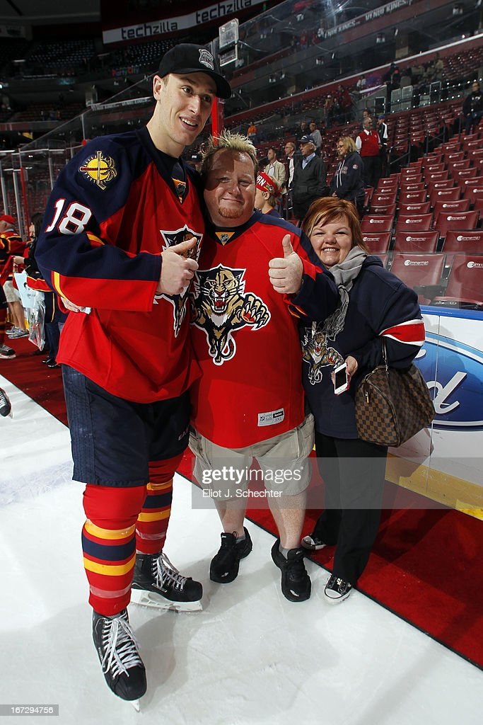 Shawn Matthias #18 of the Florida Panthers posses with fans before handing over his jersey after beating the New York Rangers at the BB&T Center on April 23, 2013 in Sunrise, Florida.
