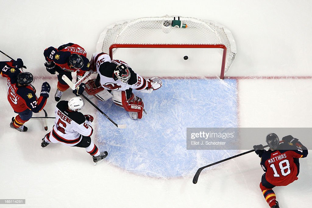 Shawn Matthias #18 of the Florida Panthers scores a third period goal to tie the game against Goaltender <a gi-track='captionPersonalityLinkClicked' href=/galleries/search?phrase=Martin+Brodeur&family=editorial&specificpeople=201594 ng-click='$event.stopPropagation()'>Martin Brodeur</a> #30 of the New Jersey Devils in the final seconds of the third period to tie the game at the BB&T Center on March 30, 2013 in Sunrise, Florida.