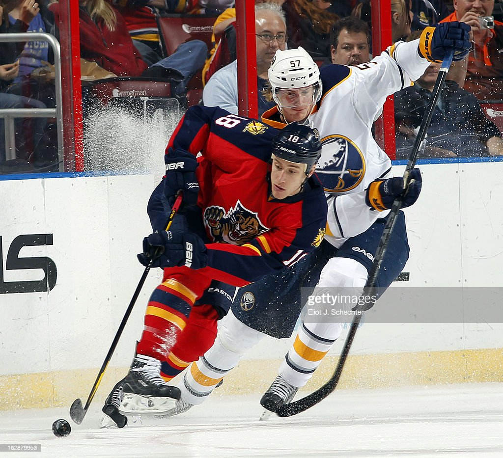 Shawn Matthias #18 of the Florida Panthers skates with the puck against Tyler Myers #57 of the Buffalo Sabres at the BB&T Center on February 28, 2013 in Sunrise, Florida.