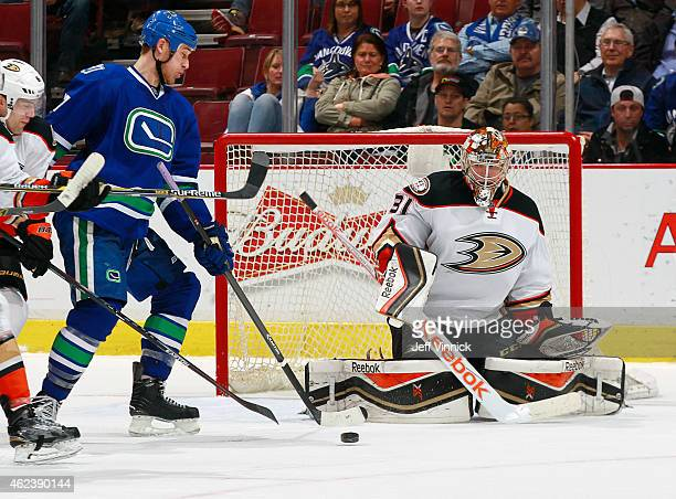 Shawn Matthias of the Vancouver Canucks uses one hand to play the puck in front of Frederik Andersen of the Anaheim Ducks during their NHL game at...