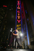 Shawn Mendes performs a pop up show on top of the marquee at Radio City Music Hall on October 22 2015 in New York City