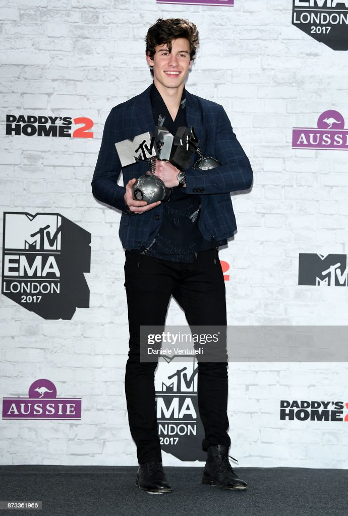 Shawn Mendes poses in the winner's room with awards for Biggest Fans, Best Artist and Best Song during the MTV EMAs 2017 held at The SSE Arena, Wembley on November 12, 2017 in London, England.