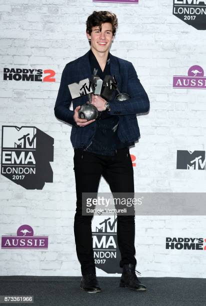 Shawn Mendes poses in the winner's room with awards for Biggest Fans Best Artist and Best Song during the MTV EMAs 2017 held at The SSE Arena Wembley...