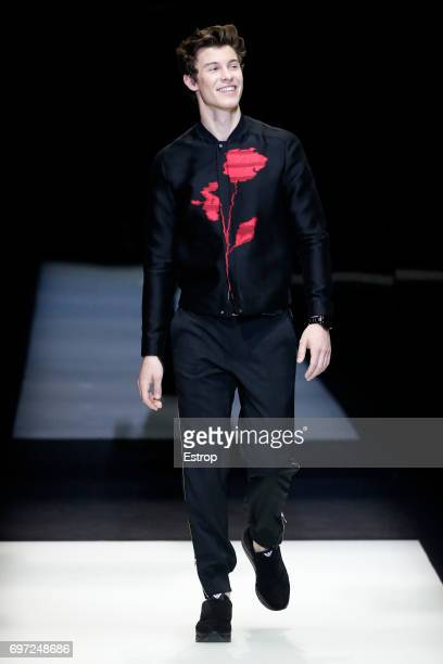 Shawn Mendes walks the runway at the Emporio Armani show during Milan Men's Fashion Week Spring/Summer 2018 on June 17 2017 in Milan Italy