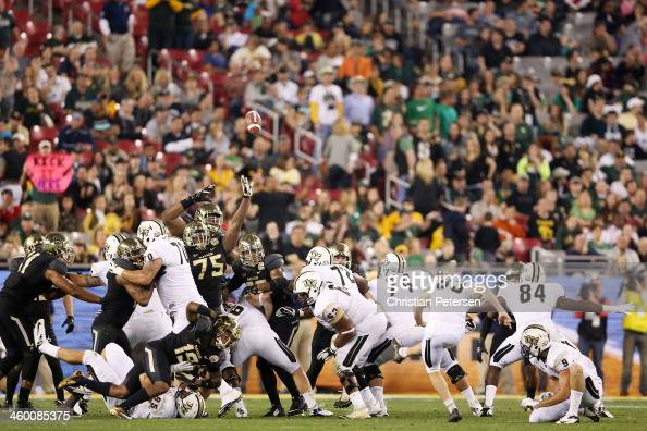 Shawn Moffitt of the UCF Knights kicks a field goal in the fourth quarter against the Baylor Bears during the Tostitos Fiesta Bowl at University of...