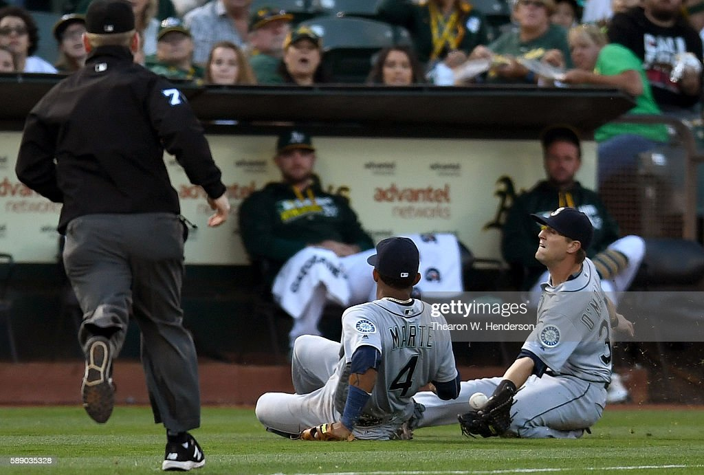 Shawn O'Malley #36 of the Seattle Mariners going after this foul pop-up goes into a slide to avoid colliding with Ketel Marte #4 against the Oakland Athletics in the bottom of the third inning at the Oakland Coliseum on August 12, 2016 in Oakland, California.