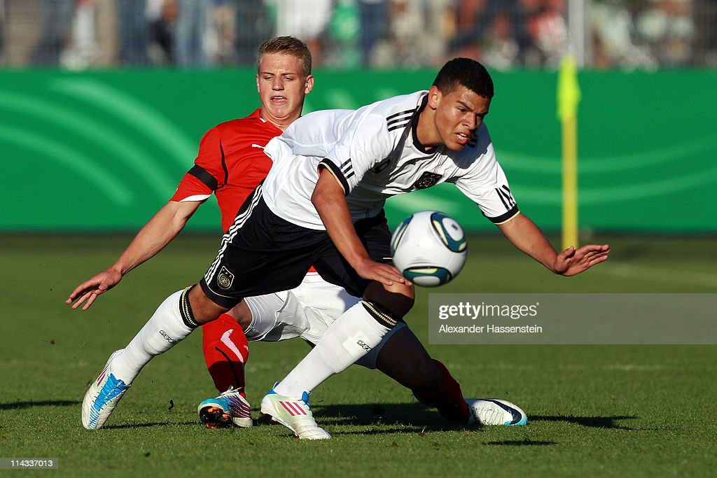 <a gi-track='captionPersonalityLinkClicked' href=/galleries/search?phrase=Shawn+Parker+-+Soccer+Player&family=editorial&specificpeople=5385069 ng-click='$event.stopPropagation()'>Shawn Parker</a> (R) of Germany battles for the ball with Christoph Martschinko of Austria during the International friendly match between the U 18 teams of Germany and Austria at Scholz Arena on May 18, 2011 in Aalen, Germany.