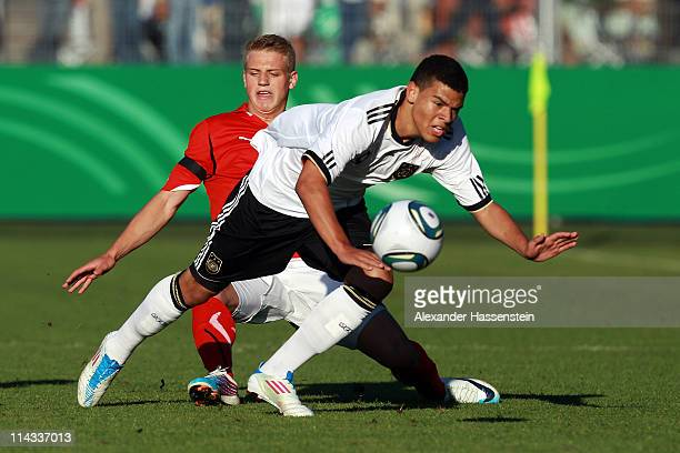 Shawn Parker of Germany battles for the ball with Christoph Martschinko of Austria during the International friendly match between the U 18 teams of...