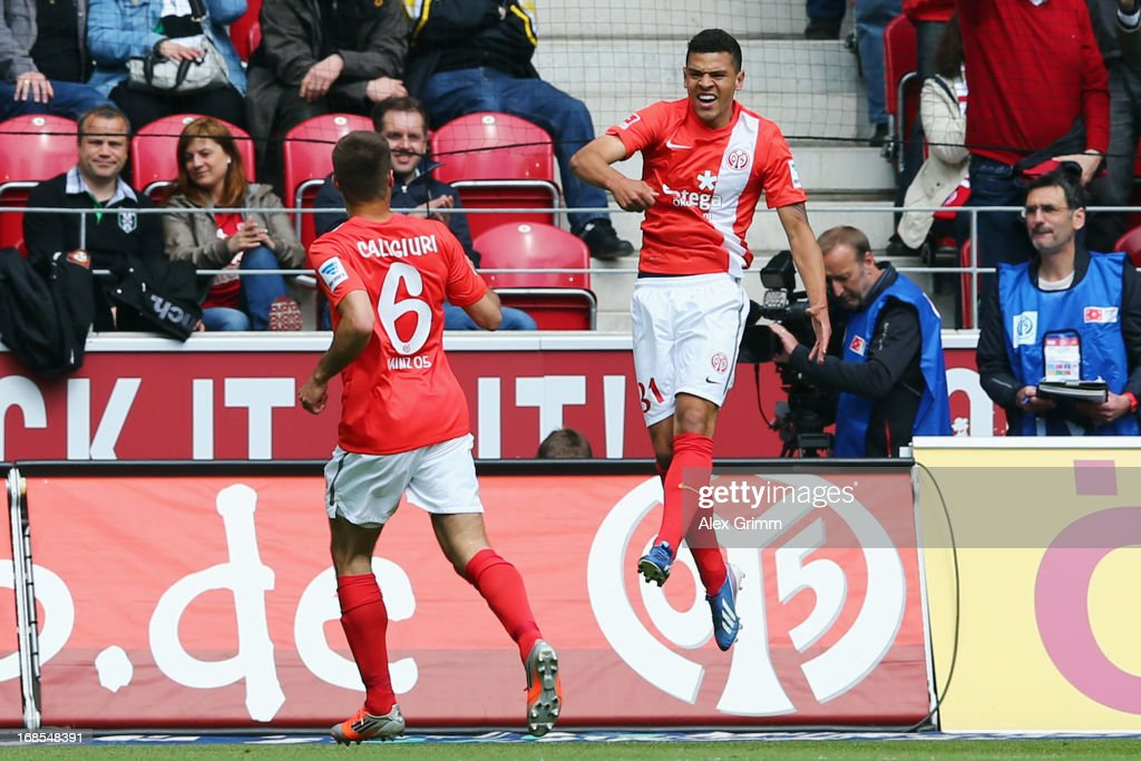Shawn Parker (R) of Mainz celebrates his team's first goal with team mate <a gi-track='captionPersonalityLinkClicked' href=/galleries/search?phrase=Marco+Caligiuri&family=editorial&specificpeople=729372 ng-click='$event.stopPropagation()'>Marco Caligiuri</a> during the Bundesliga match between 1. FSV Mainz 05 and VfL Borussia Moenchengladbach at Coface Arena on May 11, 2013 in Mainz, Germany.