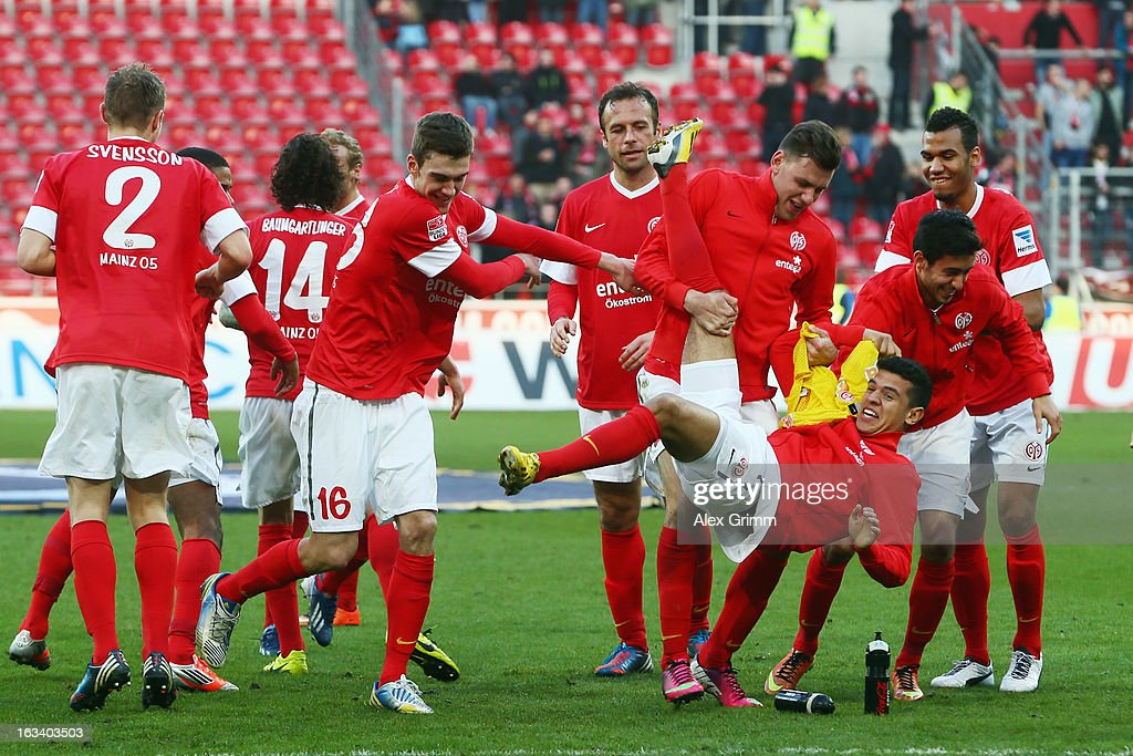 Shawn Parker of Mainz is lifted by team mates after the Bundesliga match between 1. FSV Mainz 05 and Bayer 04 Leverkusen at Coface Arena on March 9, 2013 in Mainz, Germany.