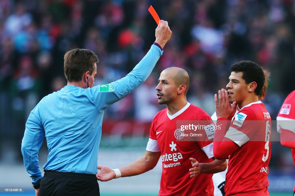 Shawn Parker (R) of Mainz is sent off by referee Tobias Stieler during the Bundesliga match between FC Augsburg and 1. FSV Mainz 05 at SGL Arena on February 10, 2013 in Augsburg, Germany.