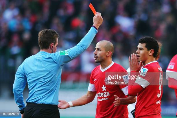 Shawn Parker of Mainz is sent off by referee Tobias Stieler during the Bundesliga match between FC Augsburg and 1 FSV Mainz 05 at SGL Arena on...