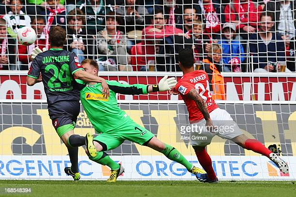 Shawn Parker of Mainz scores his team's first goal against goalkeeper MarcAndre ter Stegen and Tony Jantschke of Moenchengladbach during the...