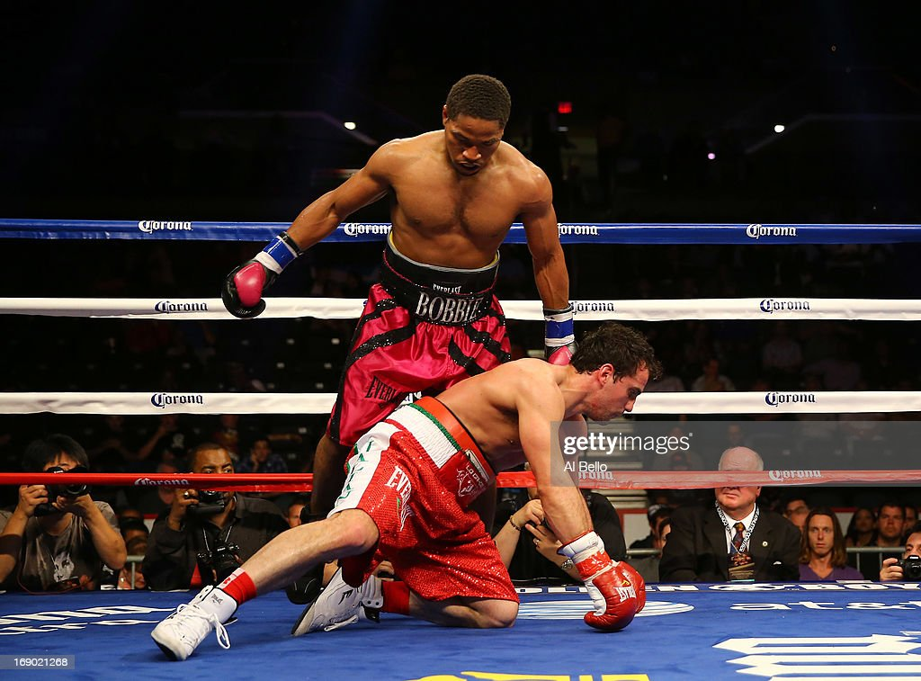 Shawn Porter knocks down Phil Lo Greco during their Junior Middleweight fight at Boardwalk Hall Arena on May 18, 2013 in Atlantic City, New Jersey.