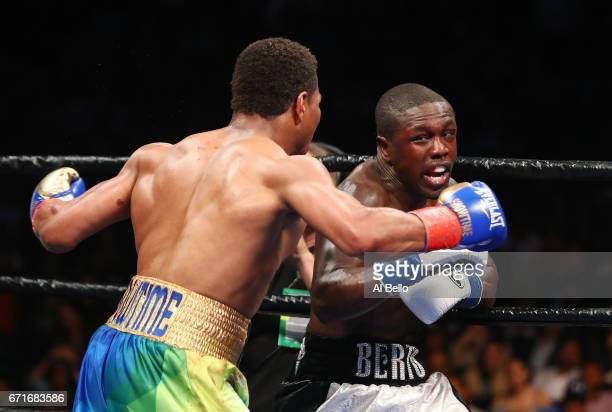 Shawn Porter punches Andre Berto during their WBC welterweight eliminator bout at the Barclays Center on April 22 2017 in New York City