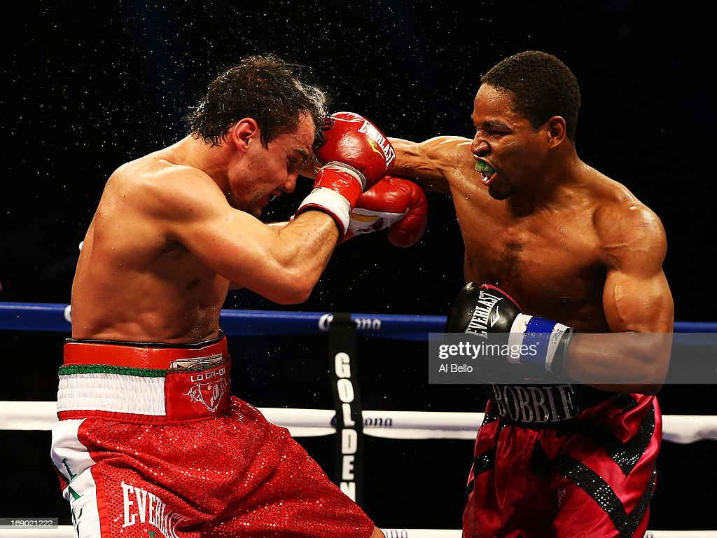 Shawn Porter punches Phil Lo Greco during their Junior Middleweight fight at Boardwalk Hall Arena on May 18, 2013 in Atlantic City, New Jersey.
