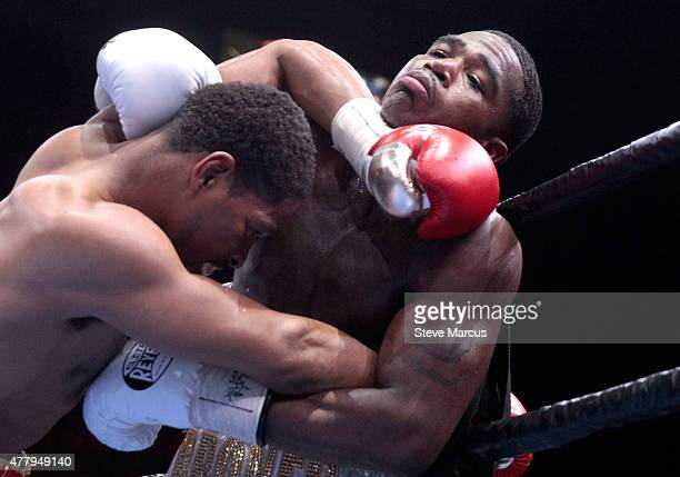 Shawn Porter pushes Adrien Broner against the ropes during their welterweight bout at MGM Grand Garden Arena on June 20 2015 in Las Vegas Nevada...