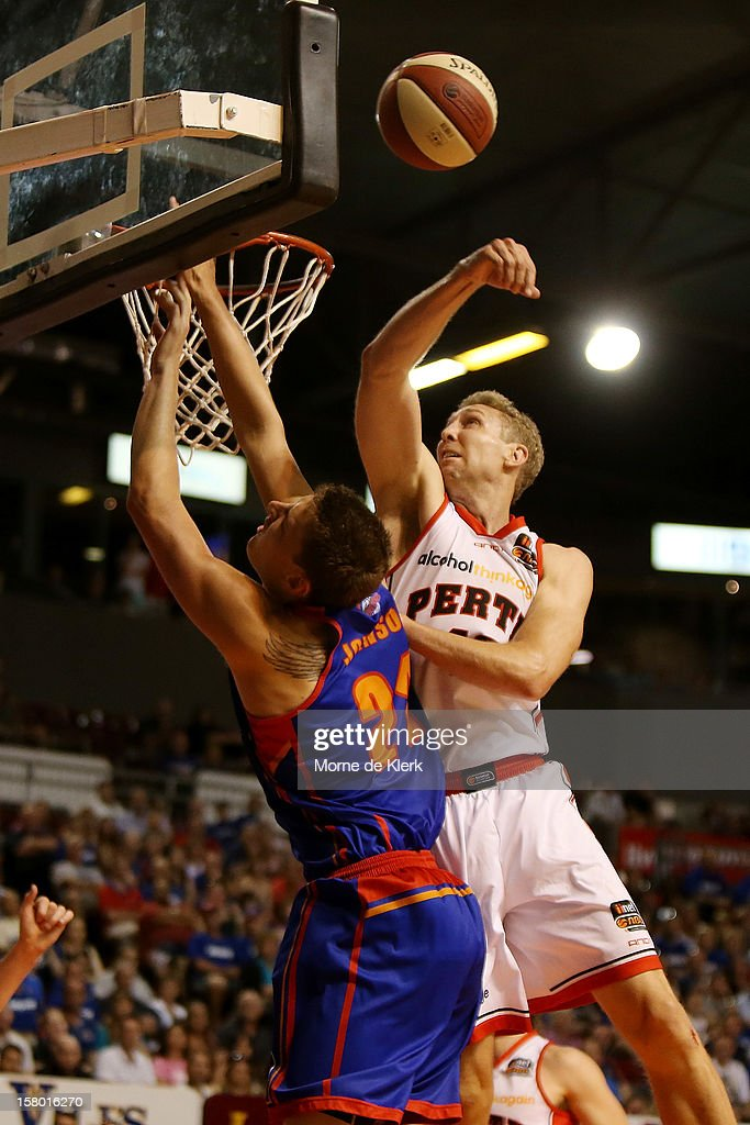 Shawn Redhage (R) of Perth blocks a shot by Daniel Johnson of Adelaide during the round ten NBL match between the Adelaide 36ers and the Perth Wildcats at Adelaide Arena on December 9, 2012 in Adelaide, Australia.