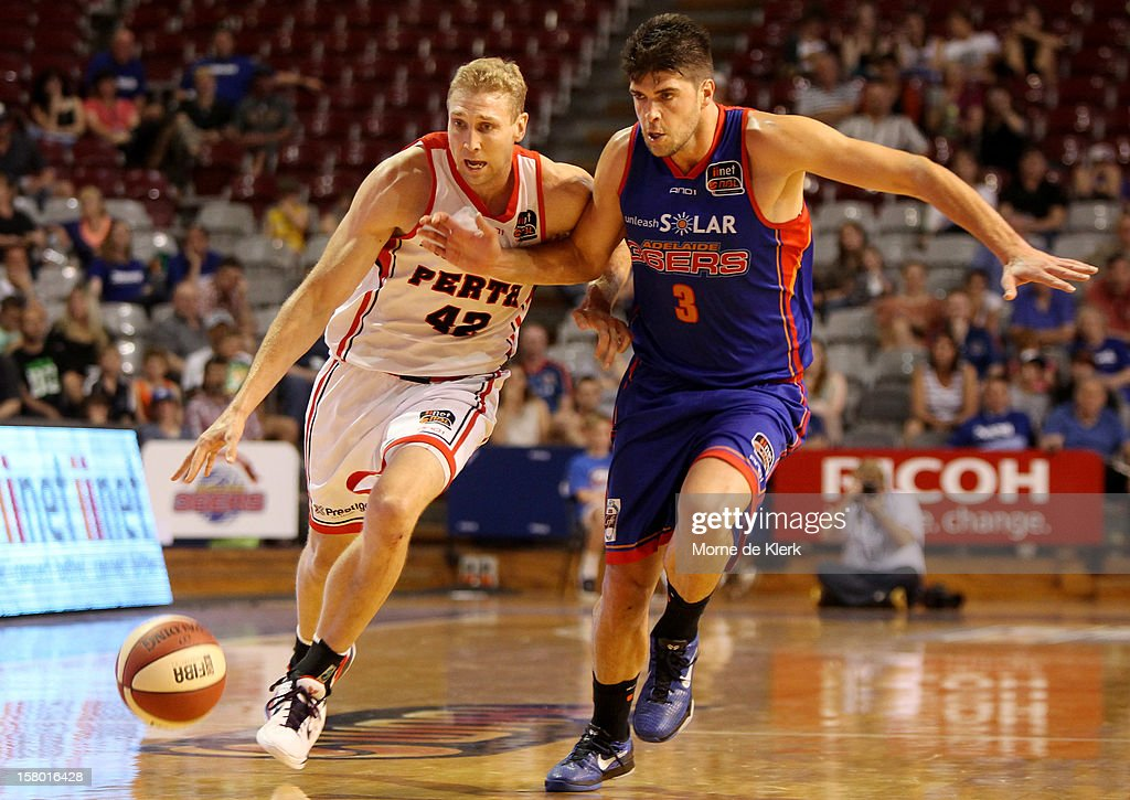 Shawn Redhage of Perth competes with Stephen Weigh of Adelaide during the round ten NBL match between the Adelaide 36ers and the Perth Wildcats at Adelaide Arena on December 9, 2012 in Adelaide, Australia.