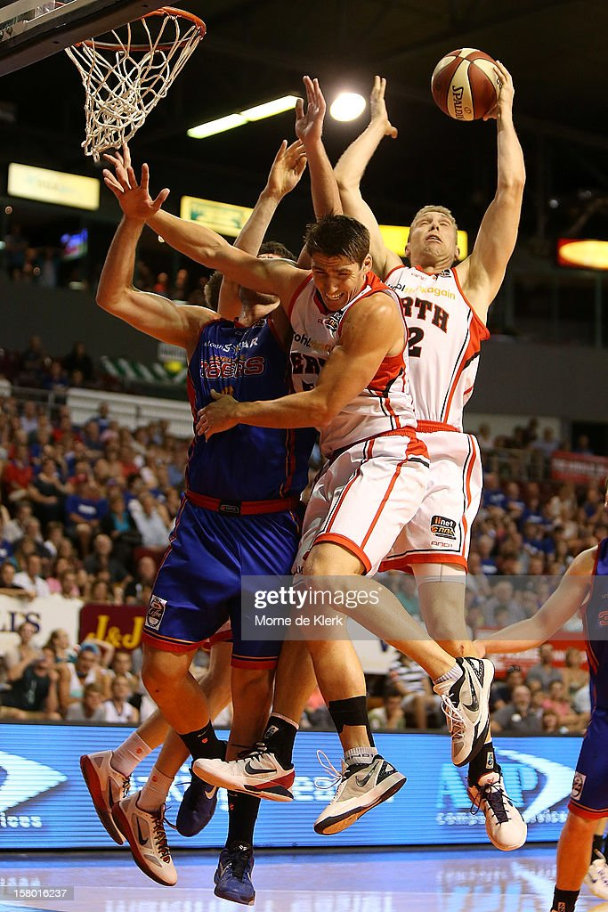 Shawn Redhage (R) of Perth wins the ball in front of the basket during the round ten NBL match between the Adelaide 36ers and the Perth Wildcats at Adelaide Arena on December 9, 2012 in Adelaide, Australia.