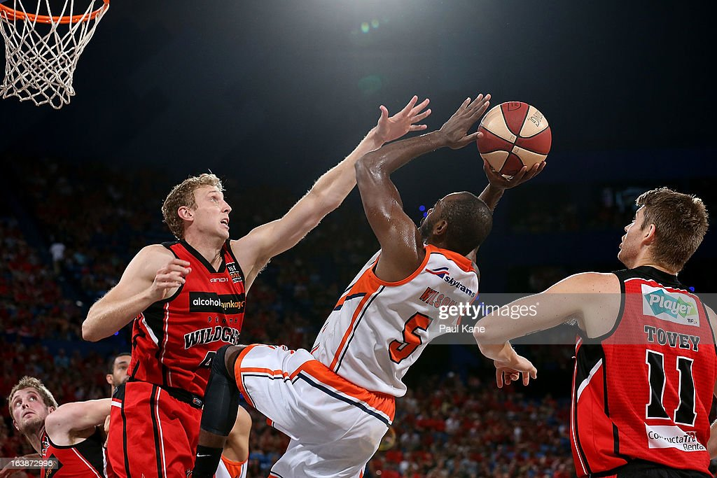 Shawn Redhage of the Wildcats blocks Jamar Wilson of the Taipans during the round 23 NBL match between the Perth Wildcats and the Cairns Taipans at Perth Arena on March 17, 2013 in Perth, Australia.