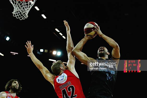 Shawn Redhage of the Wildcats defends over the top of Mika Vukona of the Breakers during the round 10 NBL match between the New Zealand Breakers and...