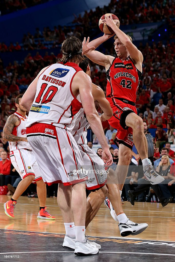 Shawn Redhage of the Wildcats dishes the ball off during game one of the NBL Semi Final Series between the Perth Wildcats and the Wollongong Hawks at Perth Arena on March 28, 2013 in Perth, Australia.