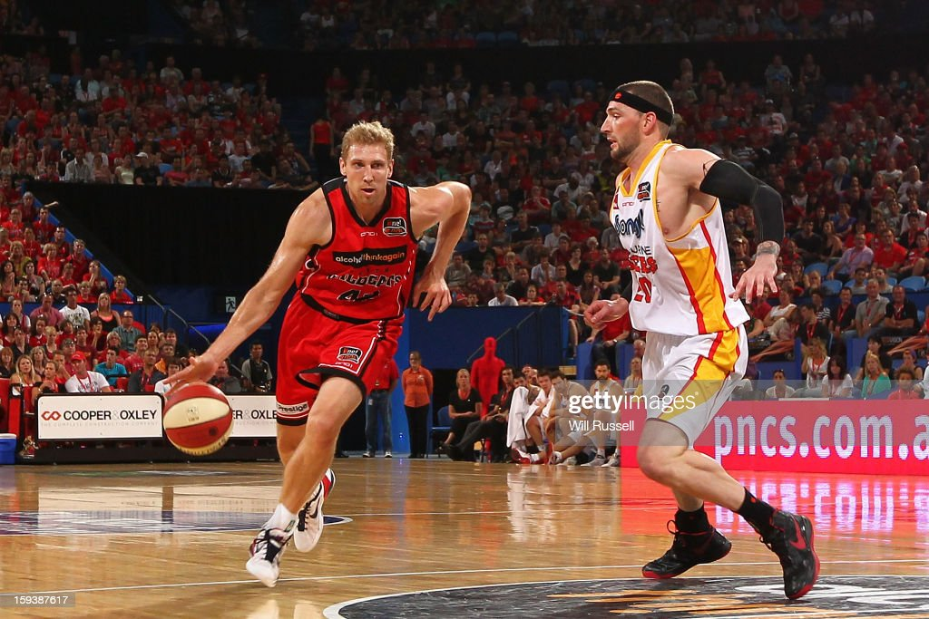 Shawn Redhage of the Wildcats dribbles the ball during the round 14 NBL match between the Perth Wildcats and the Melbourne Tigers at Perth Arena on January 13, 2013 in Perth, Australia.