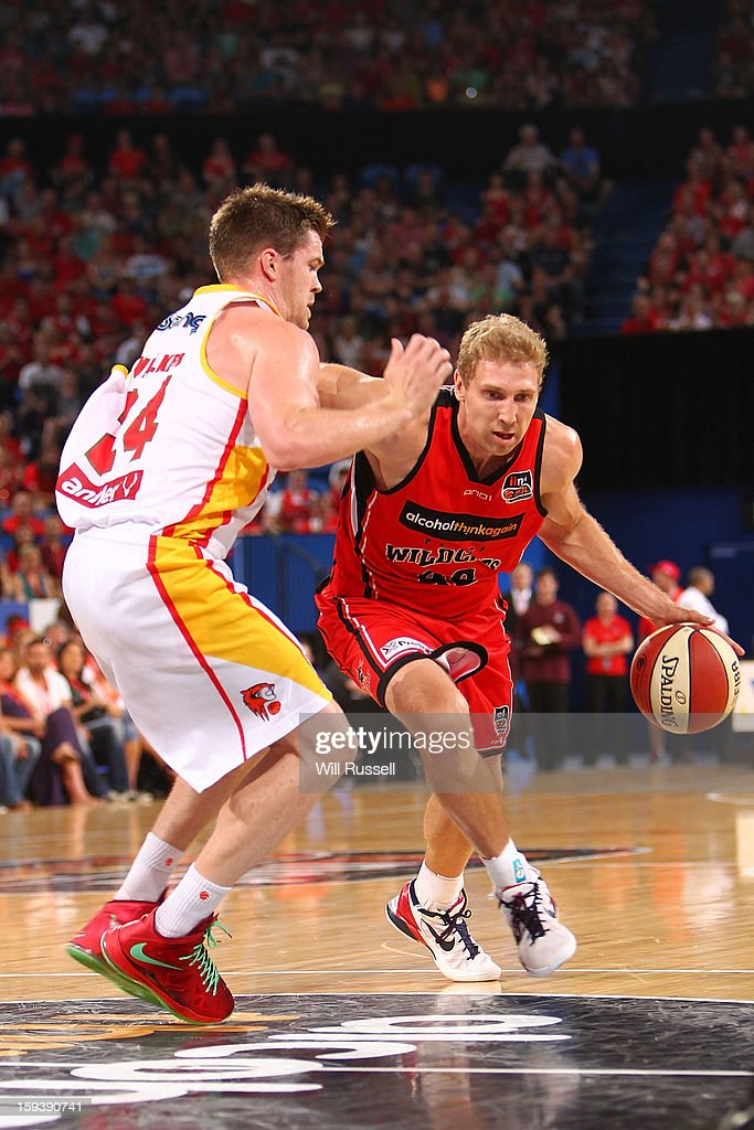 Shawn Redhage of the Wildcats dribbles the ball during the round 14 NBL match b etween the Perth Wildcats and the Melbourne Tigers at Perth Arena on January 13, 2013 in Perth, Australia.